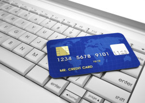 3d illustration of conceptual credit card over laptop keyboard